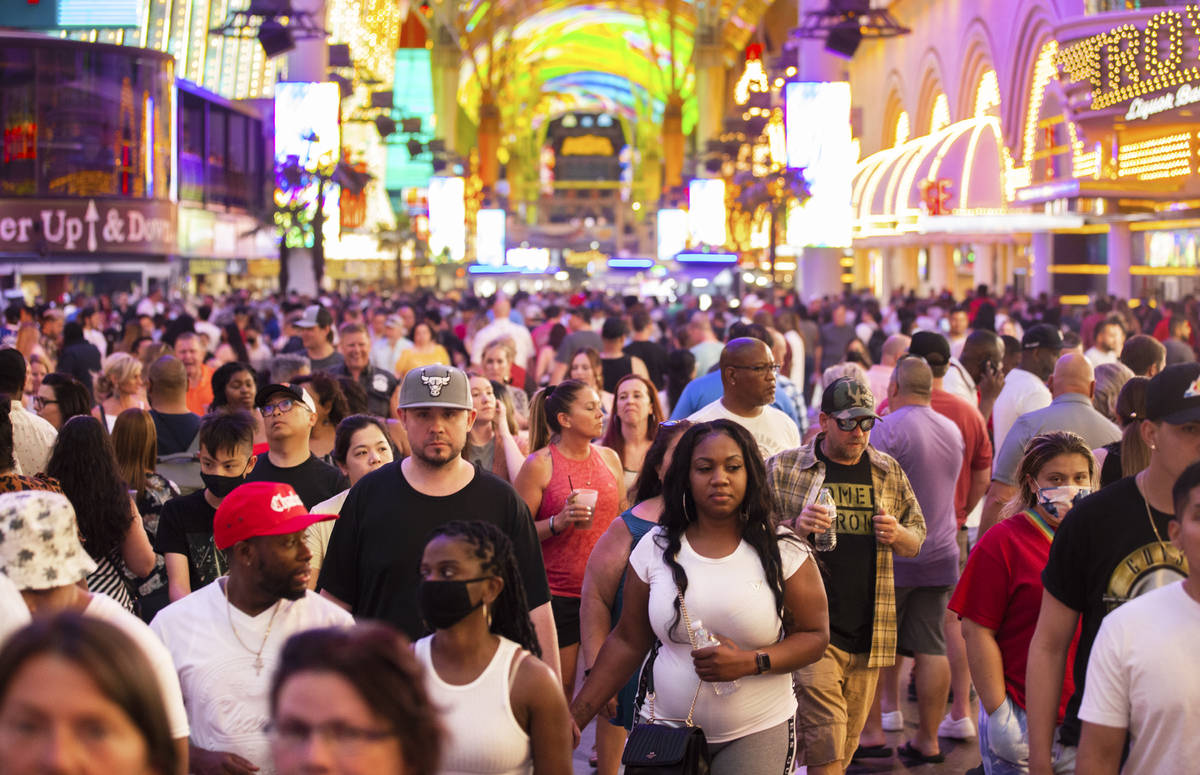 Visitors take in the sightsat the Fremont Street Experience during Memorial Day weekend on Satu ...
