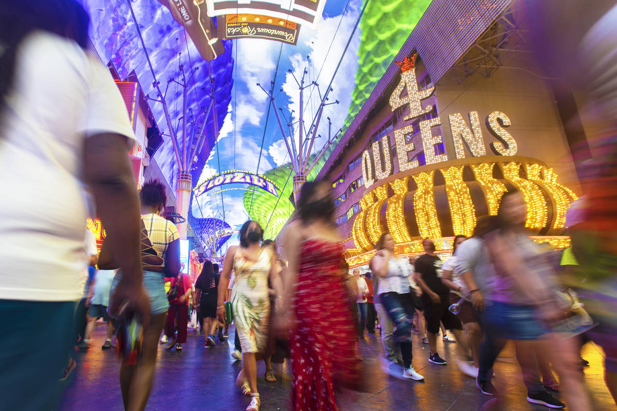 Visitors take in the sites at the Fremont Street Experience during Memorial Day weekend on Satu ...