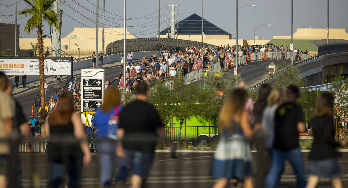 Fans make their way in the heat to the Garth Brooks concert at Allegiant Stadium on Friday, Jul ...