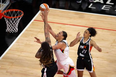 Phoenix Mercury center Brittney Griner (42) blocks a shot by Las Vegas Aces center Liz Cambage ...