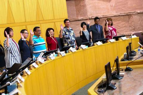 Members of the Asian-American Pacific Islanders Community Commission are sworn in at the Clark ...