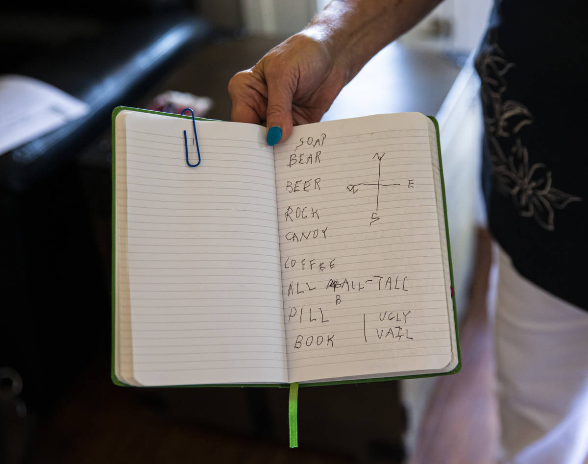 Donna Peterson shows some of the notes in a journal belonging to her husband, Byron Peterson, n ...