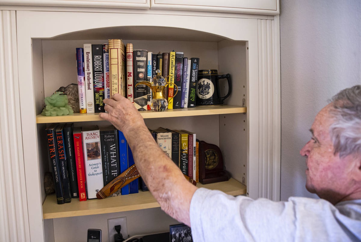 Byron Peterson, who has Wernicke's aphasia, a speech and comprehension disorder, points to book ...