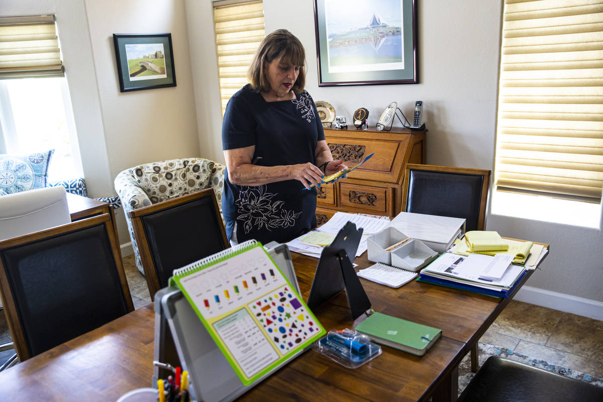Donna Peterson shows some of the different items used to help her husband, Byron Peterson, not ...