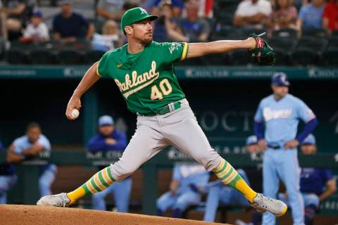 Oakland Athletics starting pitcher Chris Bassitt throws against the Texas Rangers during the fi ...