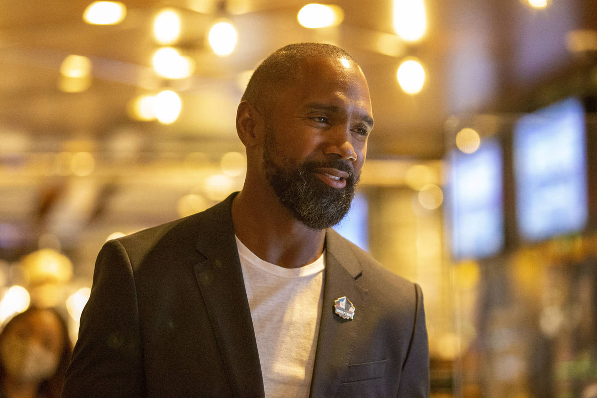 Former Raiders defensive back and Hall of Famer Charles Woodson is interviewed at the ribbon cu ...