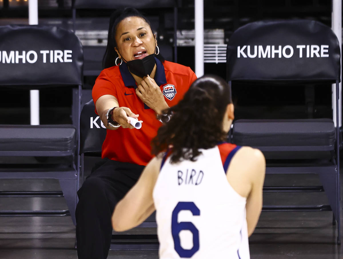 United States head coach Dawn Staley talks with guard Sue Bird (6) before the start of an exhib ...