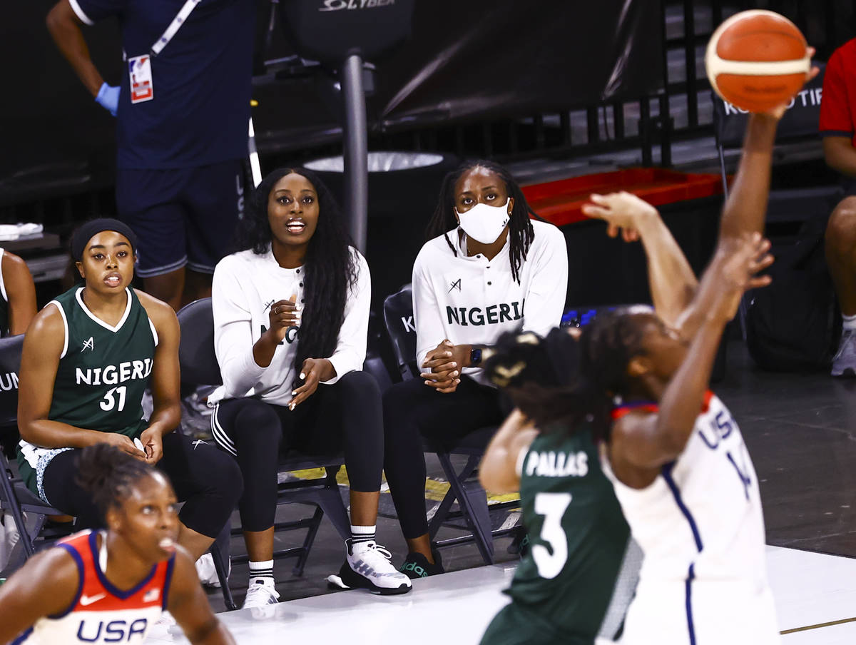 Nigeria guard Erica Ogwumike (31), left, watches the action alongside sisters Chiney Ogwumike, ...