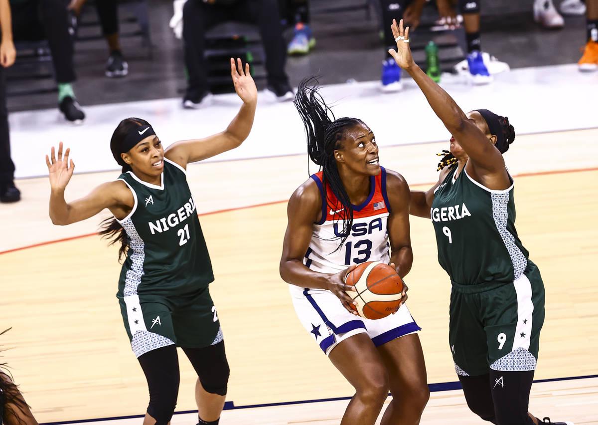 United States center Sylvia Fowles (13) looks to shoot between Nigeria guard Atonye Nyingifa (2 ...