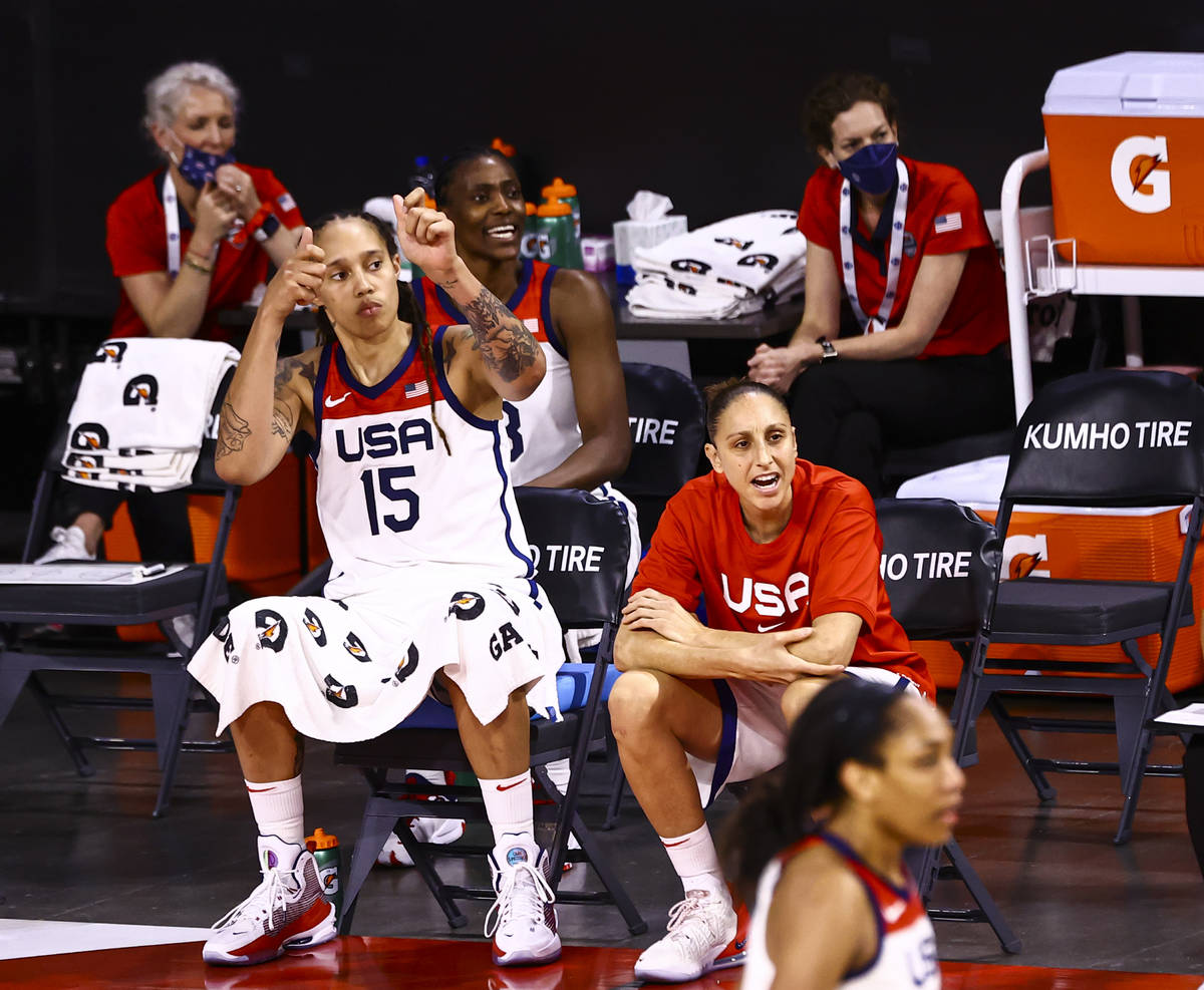United States center Brittney Griner (15) and guard Diana Taurasi, right watch the action durin ...