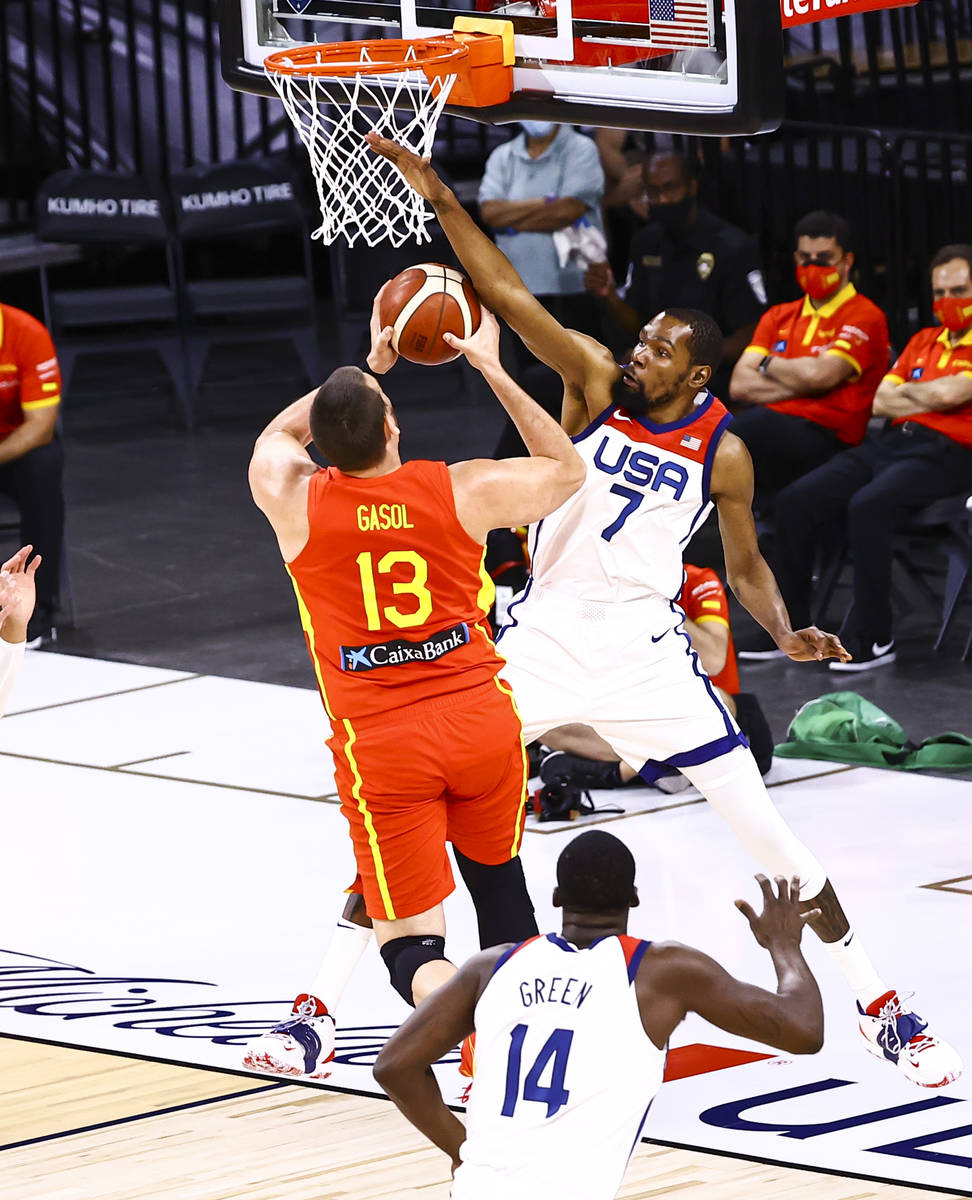 United States forward Kevin Durant (7) blocks Spain center Marc Gasol (13) during the first hal ...