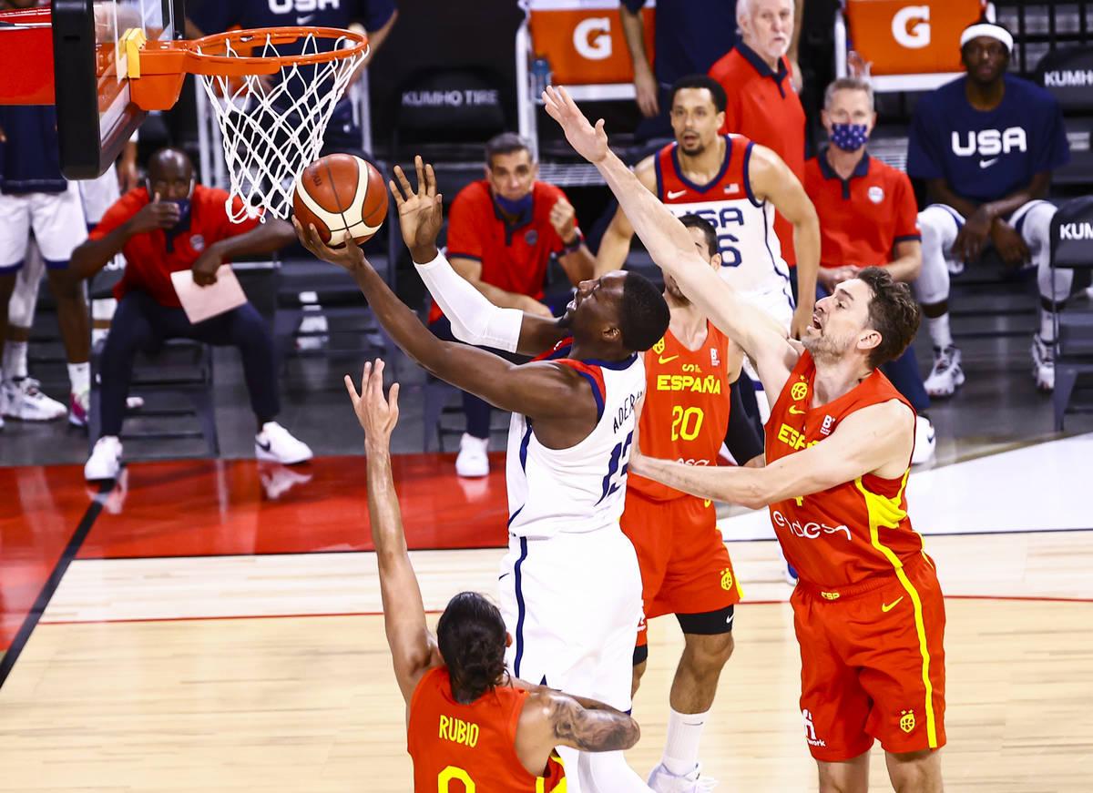 United States center Bam Adebayo (13) goes to the basket past Spain center Pau Gasol (4) during ...