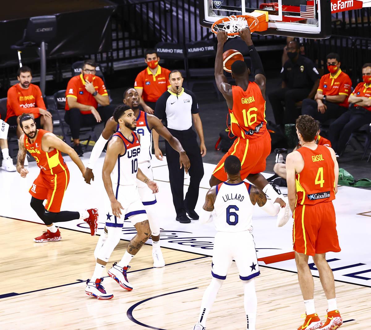 Spain power forward Usman Garuba (16) dunks the ball against the United States during the first ...