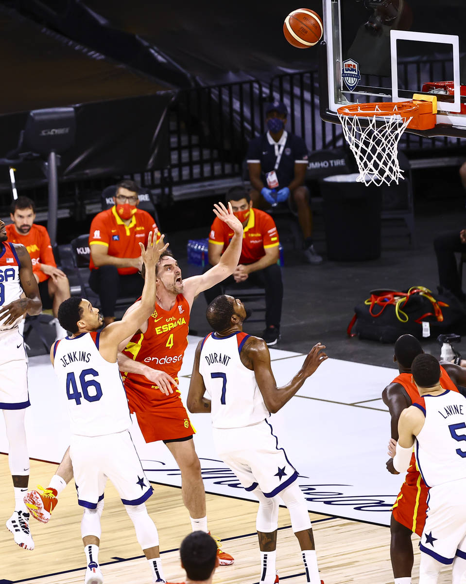 Spain center Pau Gasol (4) lays up the ball between United States guard John Jenkins and forwar ...