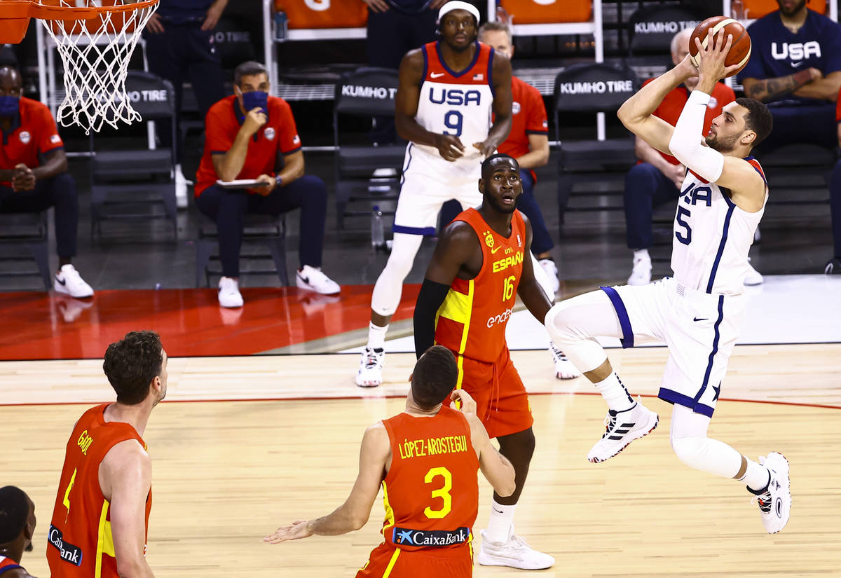 United States guard Zach Lavine (5) shoots in front of Spain forward Usman Garuba (16) during t ...