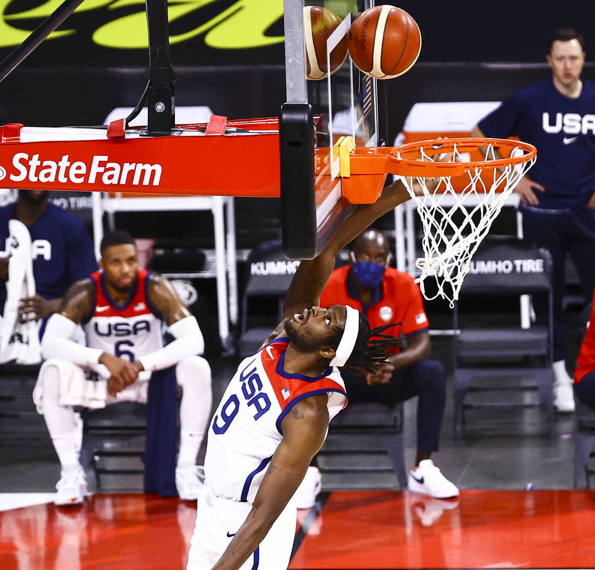 United States forward Jerami Grant (9) lays up the ball against Spain during the first half of ...