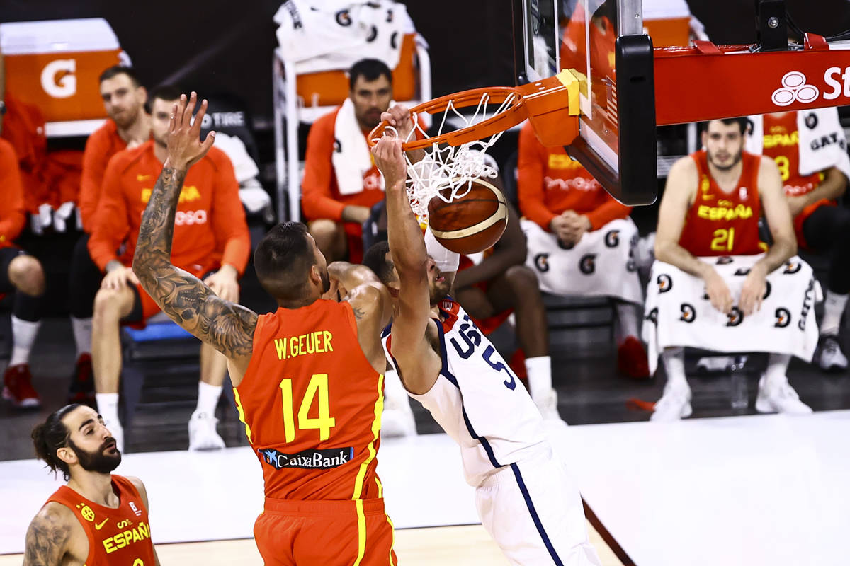 United States guard Zach Lavine (5) dunks the bal in front of Spain center Willy Hernangomez (1 ...