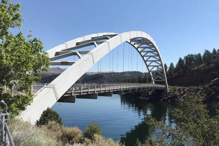 The Cart Creek Bridge spans a lovely side canyon of Flaming Gorge near Dutch John, Utah. (Debor ...