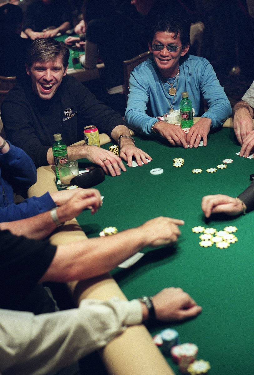 Scotty Nguyen, right, and Layne Flack smile as they play during the World Poker Tour at the Bel ...