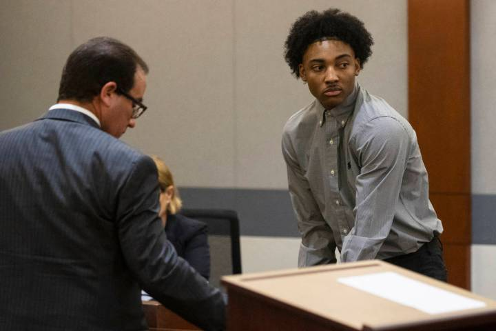 Former Bishop Gorman High School basketball standout Zaon Collins, right, and his attorney Rich ...