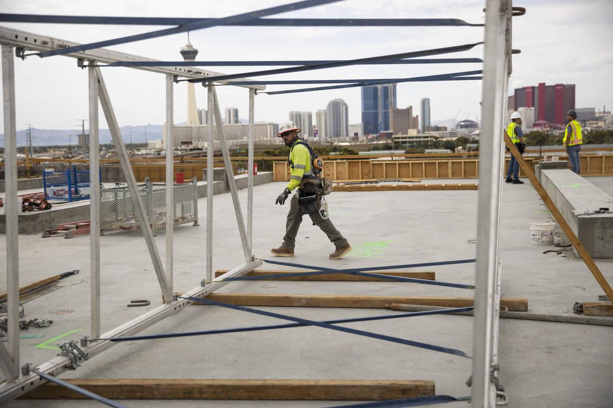 Carpenter Herminio Serna works on the building rooftop of the Kirk Kerkorian School of Medicine ...