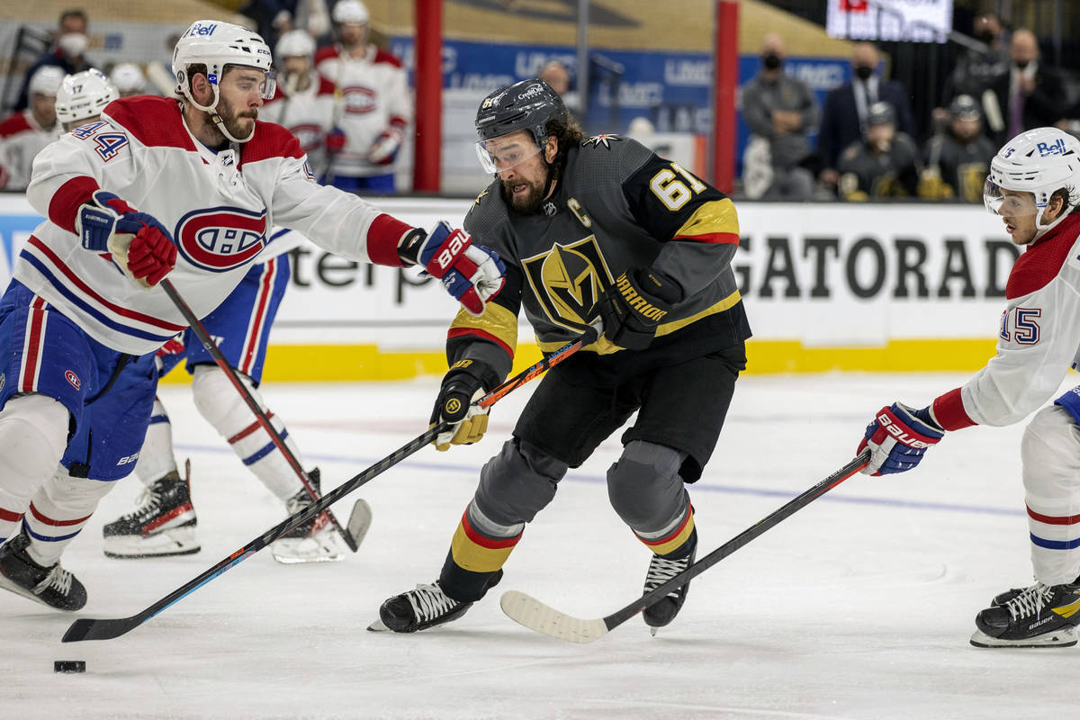 Golden Knights right wing Mark Stone (61) battles for control of the puck with Montreal Canadie ...