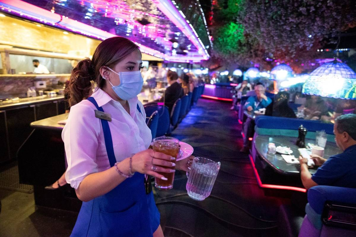 Server Kelly Arizmendi delivers food and drinks to customers at Peppermill Las Vegas restaurant ...