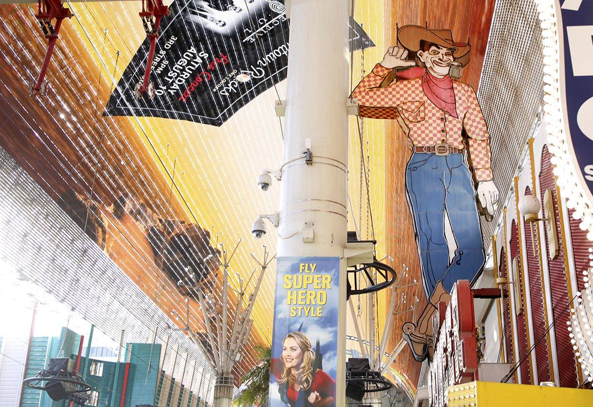 The iconic Vegas Vic neon sign in front of the now closed Pioneer Club on the Fremont Street Ex ...