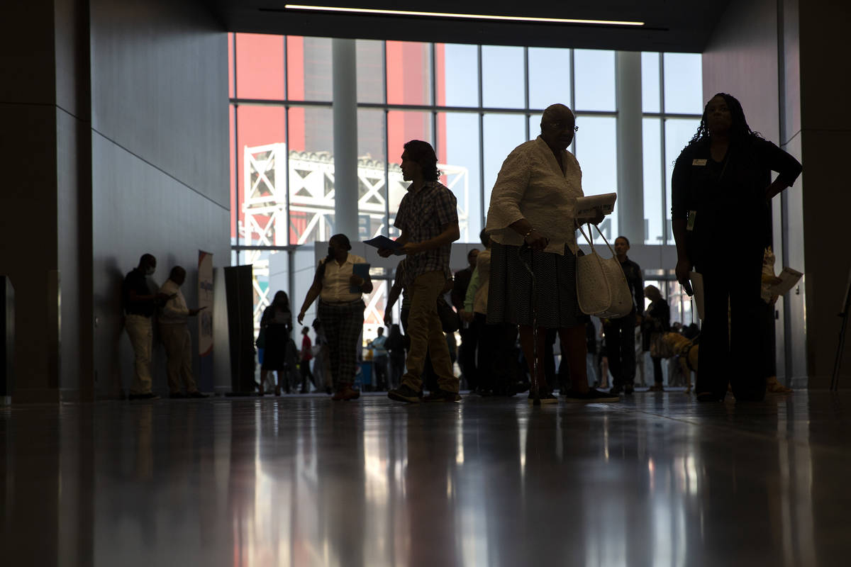 People enter the Las Vegas Convention Center for a summer job fair hosted by Clark County on Fr ...