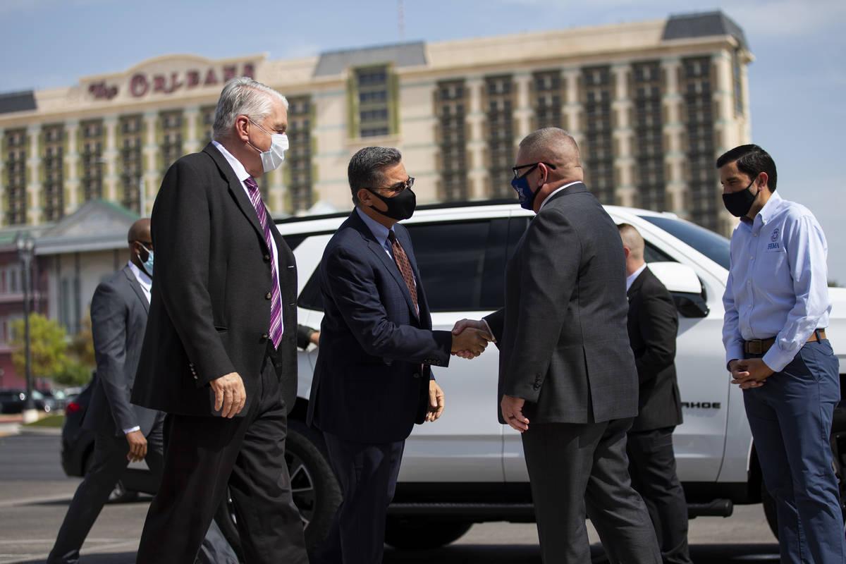 Nevada Governor Steve Sisolak, from left, U.S. Health and Human Services Secretary Xavier Becer ...
