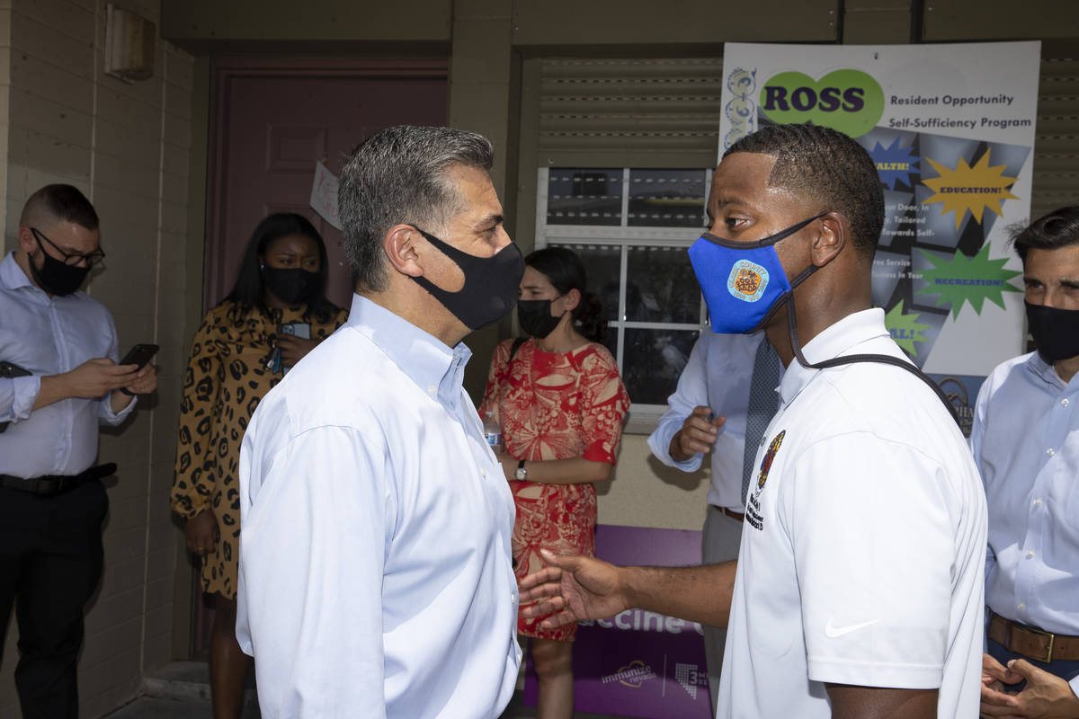 Health and Human Services Secretary Xavier Becerra, left, and Clark County Commissioner William ...