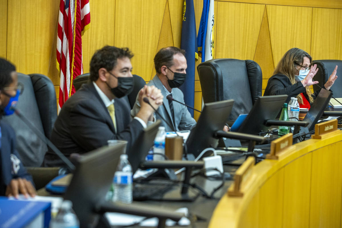 Clark County Commission Chairman Marilyn Kirkpatrick, right, instructs people during public com ...