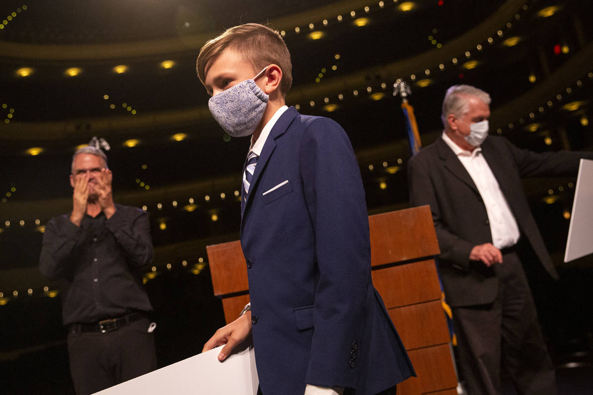 Jax B. leaves the stage with a check for a $5,000 college savings plan during the announcement ...