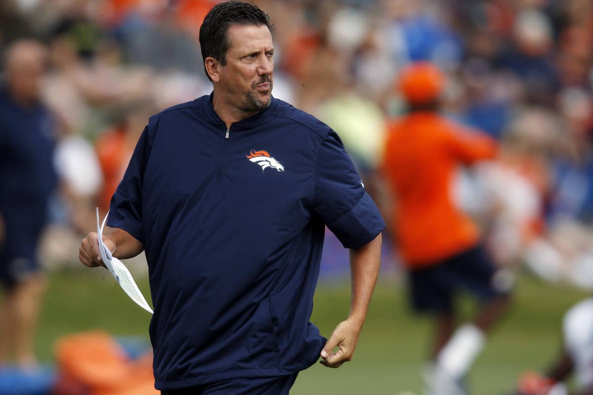 FILE - In this Aug. 4, 2016, file photo, Denver Broncos quarterbacks coach Greg Knapp watches d ...