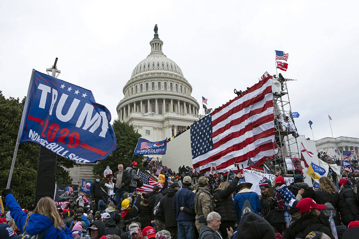 Rioters loyal to then-President Donald Trump outside of U.S. Capitol on Jan. 6, 2021, in Washi ...
