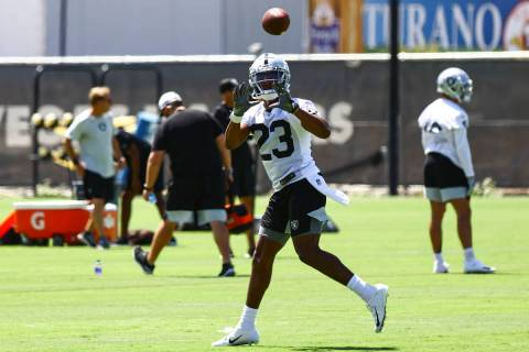 Raiders running back Kenyan Drake (23) looks to make the catch during NFL football practice at ...