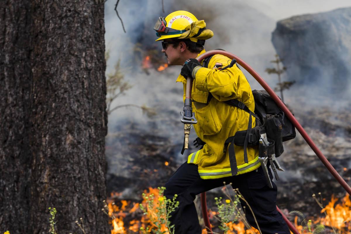 A So-Cal fireman battles the Tamarack Fire around California State Route 88 near Alpine Village ...