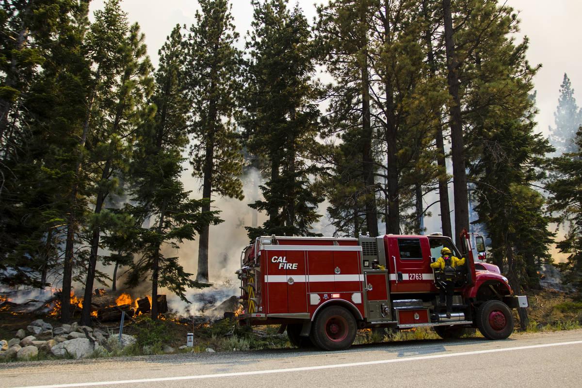 So-Cal firefighters battle the Tamarack Fire around California State Route 88 near Alpine Villa ...