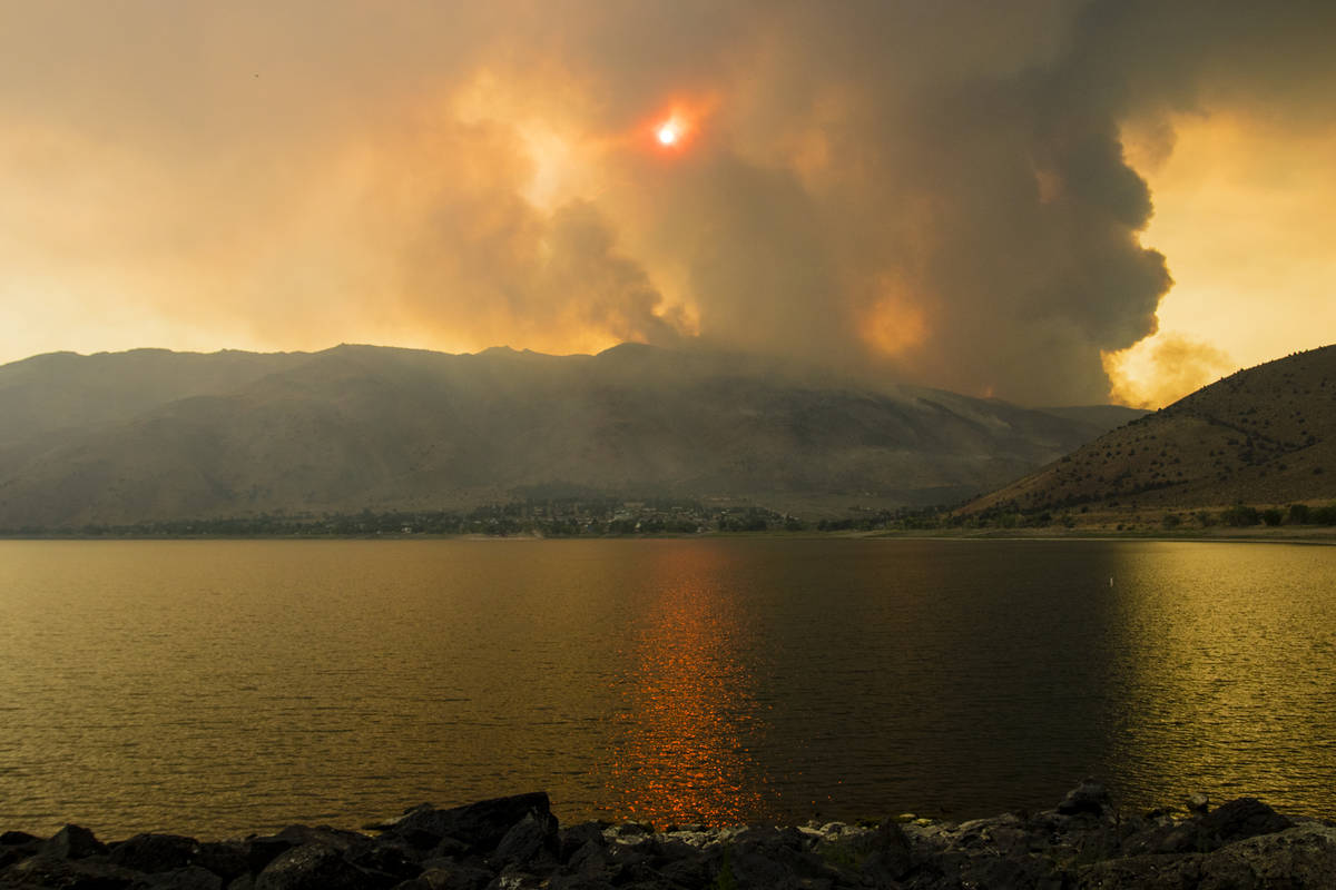 The Tamarack Fire burns around Topaz Lake, Nev., Friday, July 23, 2021. (Ty Oneil/Special to th ...
