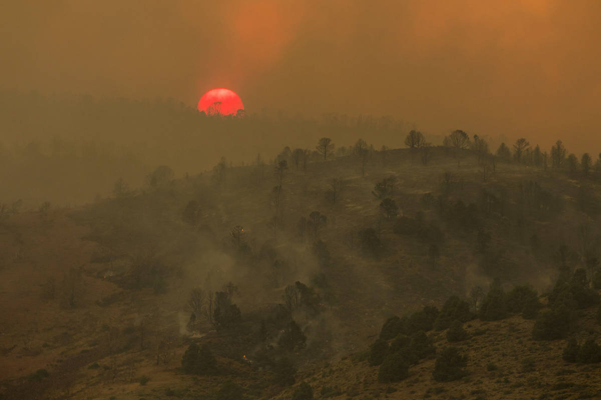 Sunset is seen as the Tamarack Fire burns around Topaz Lake, Nev., Friday, July 23, 2021.(Ty On ...