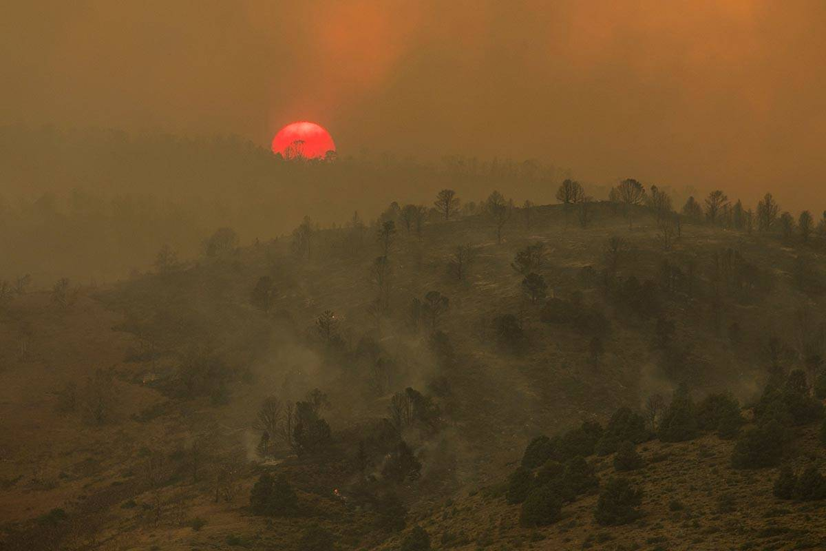 Sunset is seen as the Tamarack Fire burns around Topaz Lake, Nev., Friday, July 23, 2021. Nevad ...