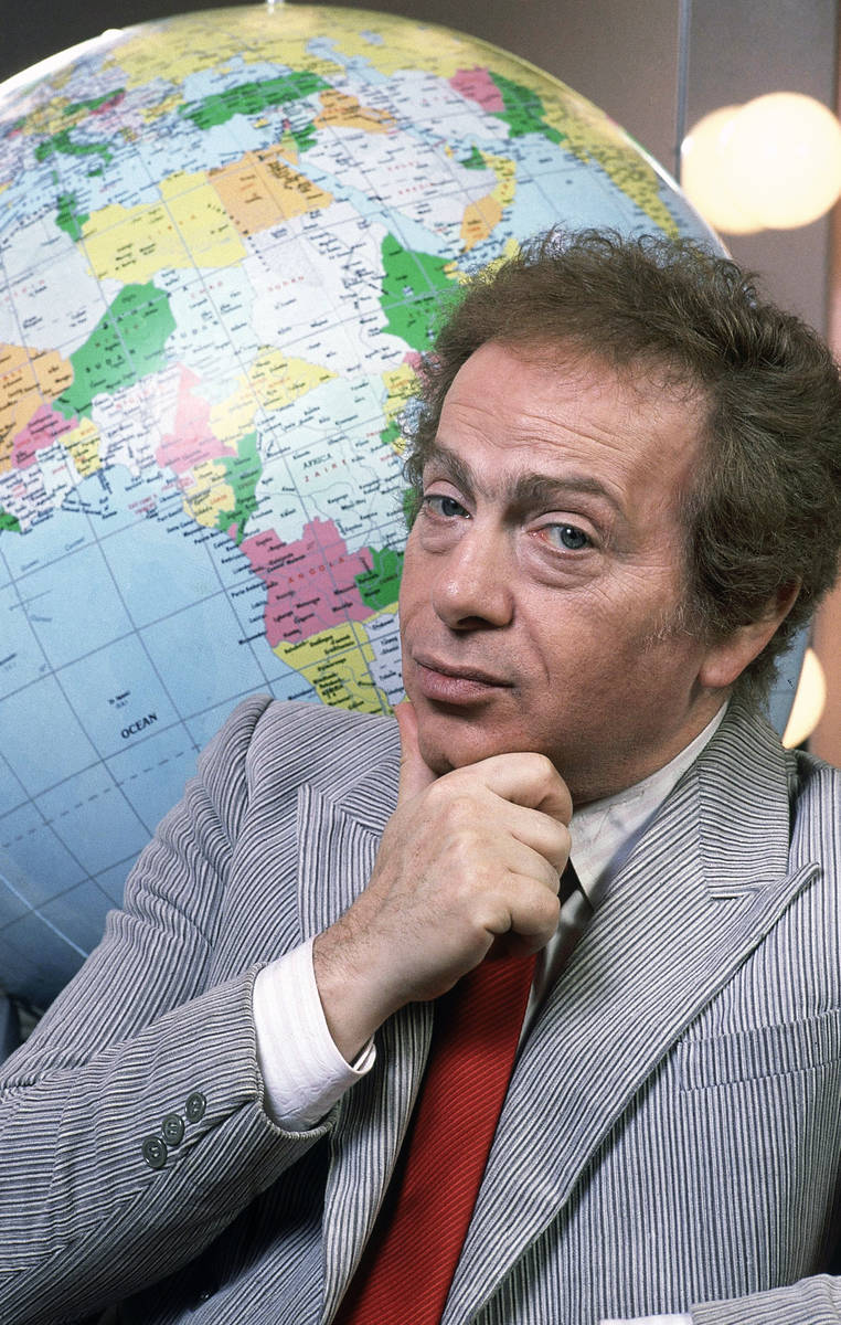 FILE - In this Jan. 27, 1987, file photo, Jackie Mason poses in his dressing with a globe as he ...