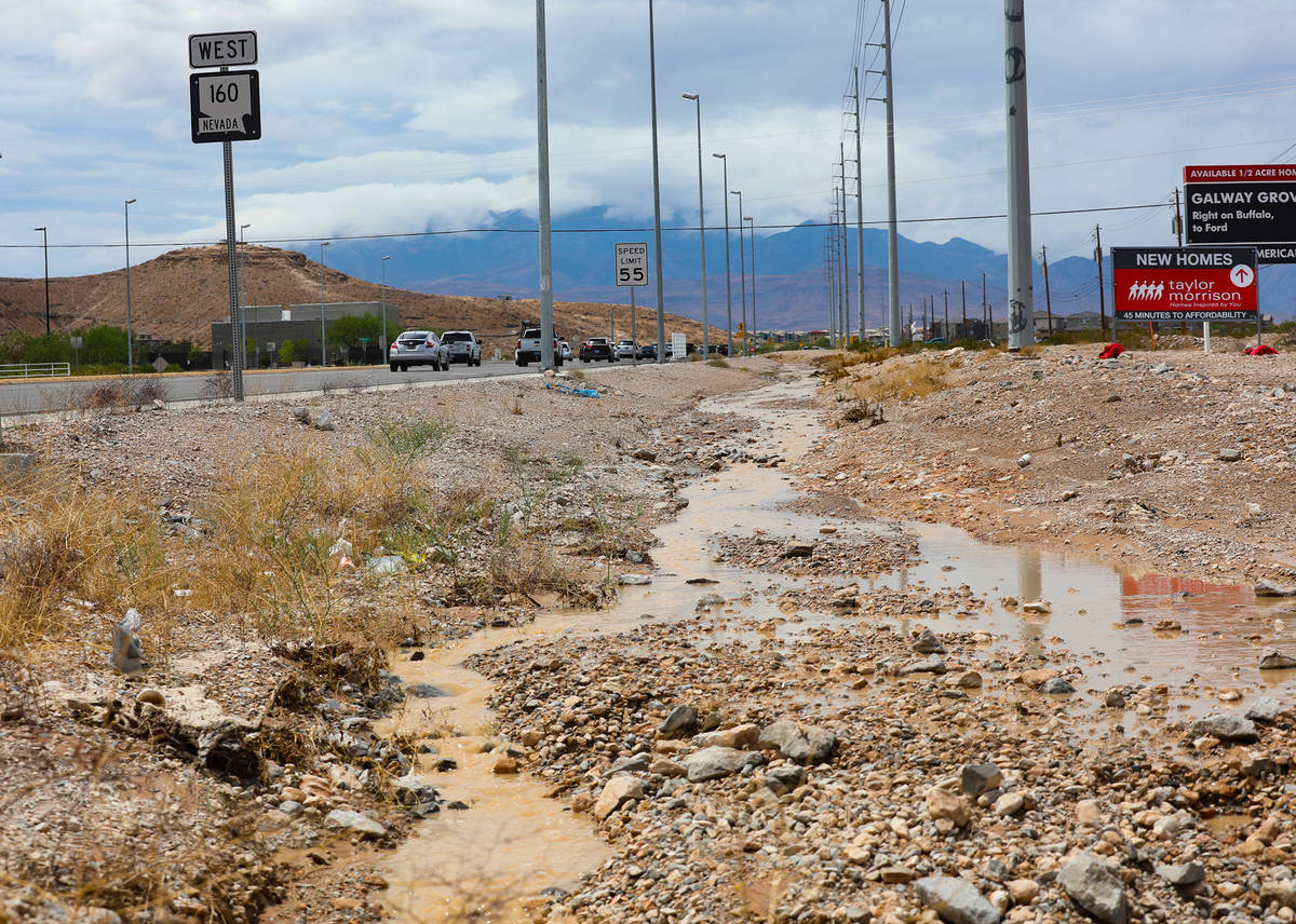 Water flows in a ditch adjacent to Blue Diamond Road in Las Vegas, Monday, July 26, 2021. (Rach ...