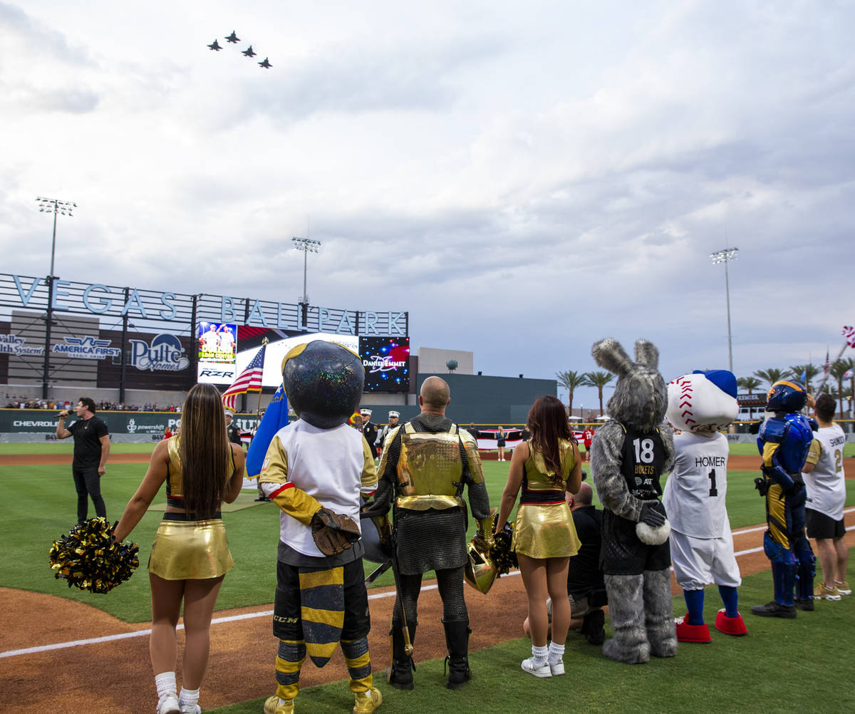 Nellis AFB F-35 jets fly over the Las Vegas Ballpark for a charity softball game involving pla ...