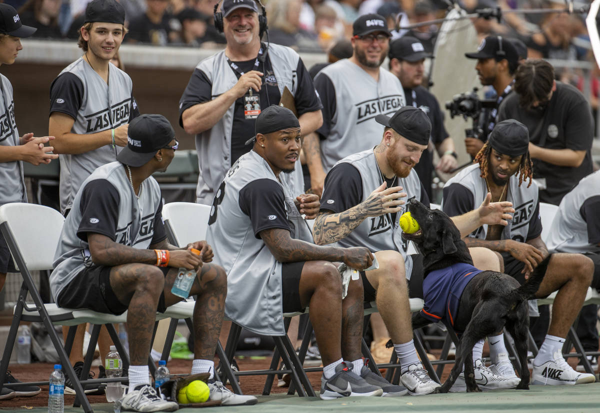 Las Vegas Raiders Josh Jacobs (28, center) looks on as teammate Maxx Crosby (98) and Damon Arne ...