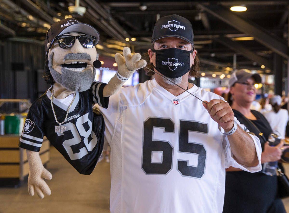 The Raider Puppet makes an appearance during a charity softball game involving teammates from t ...