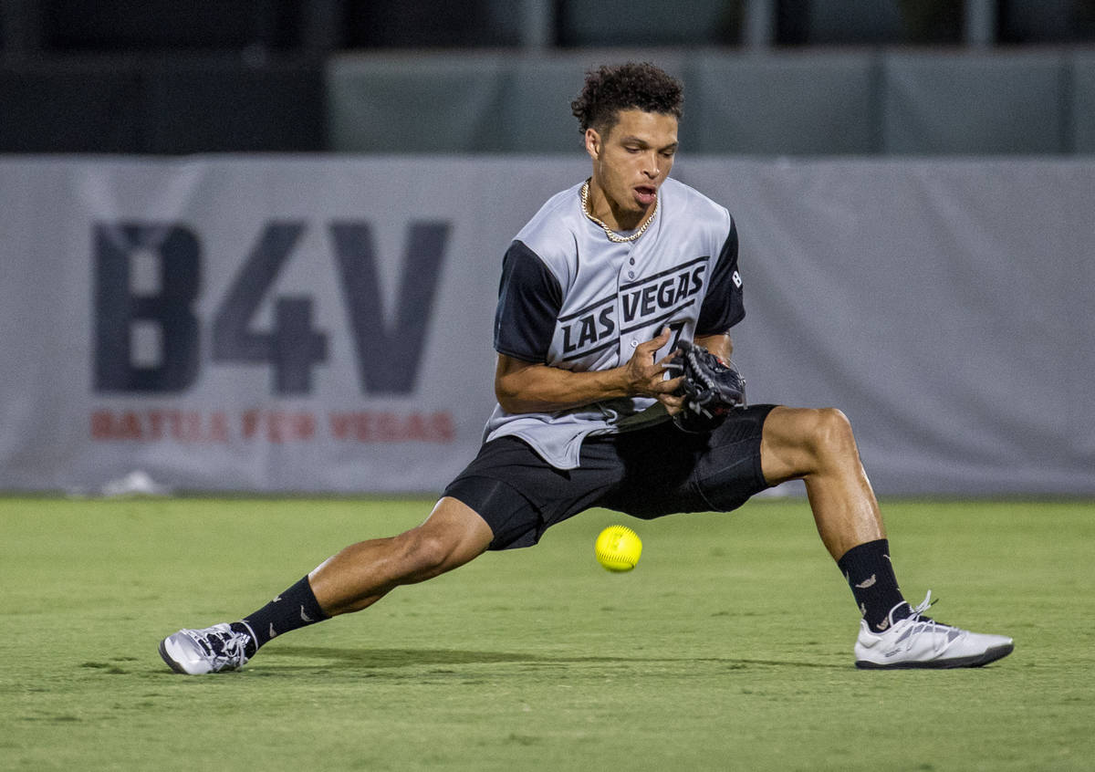 Las Vegas Raiders Willie Snead IV (17) loses a fly ball during a charity softball game versus t ...