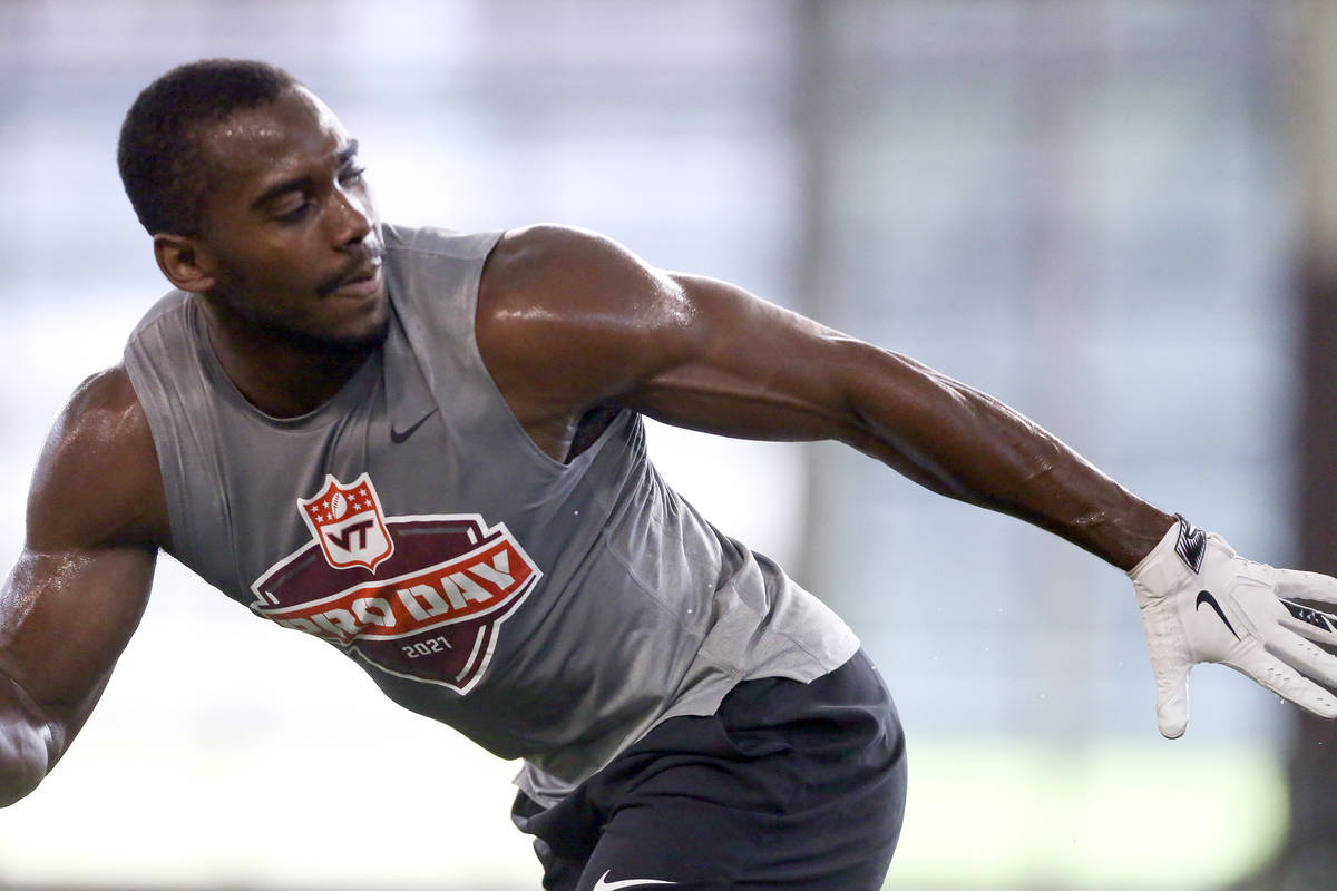 Divine Deablo runs during Virginia Tech pro day, attended by NFL football scouts, in Blacksburg ...