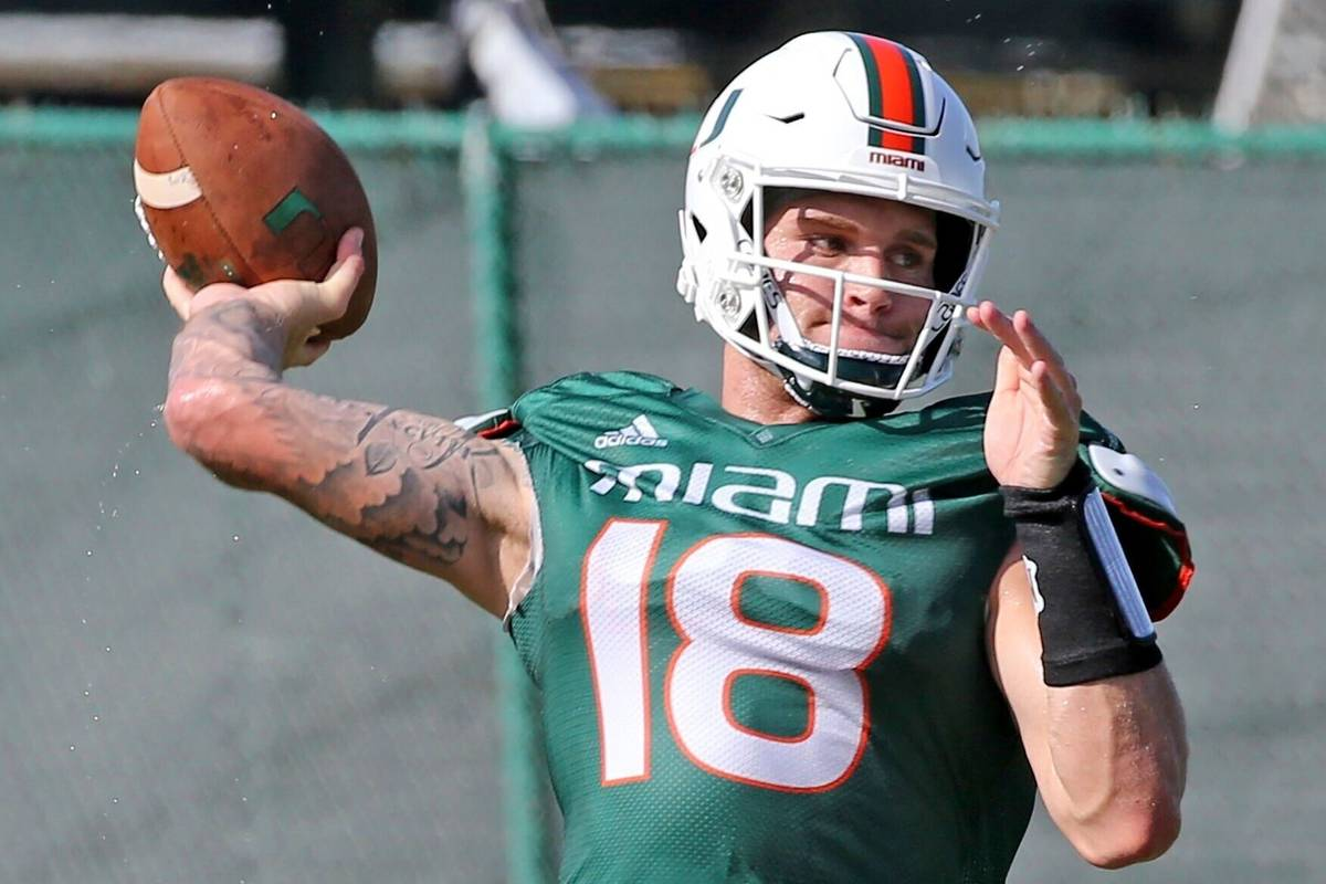 Miami quarterback Tate Martell (18) throws the ball during NCAA college football practice in Co ...