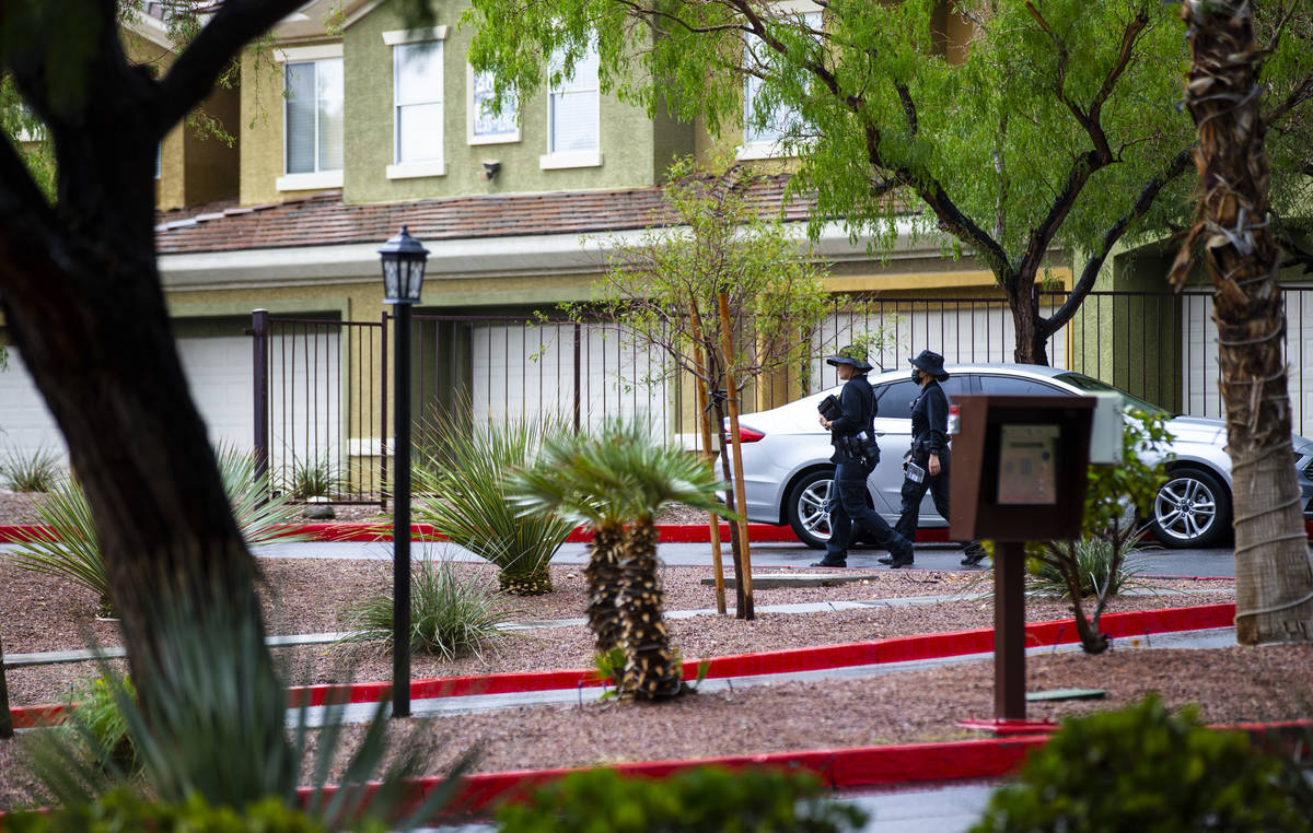 Police investigate a homicide Monday, July 26, 2021, on the 2600 block of South Pavilion Center ...